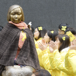 "Demonstrators gather in March 2017 around a statue representing former ""comfort women"" installed in front of the Japanese Embassy in Seoul, to protest against a move to remove it. Photo: Kyodo."